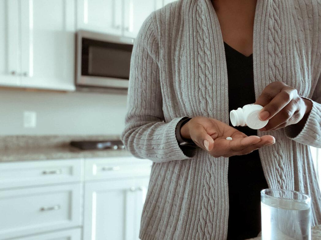 woman taking aspirin